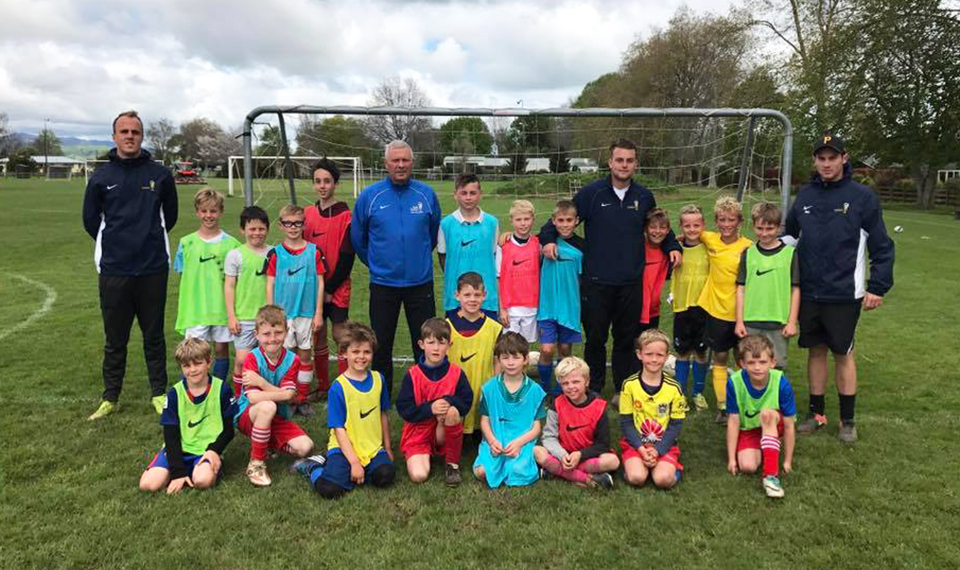 Cambridge youngsters brave wet weather for football