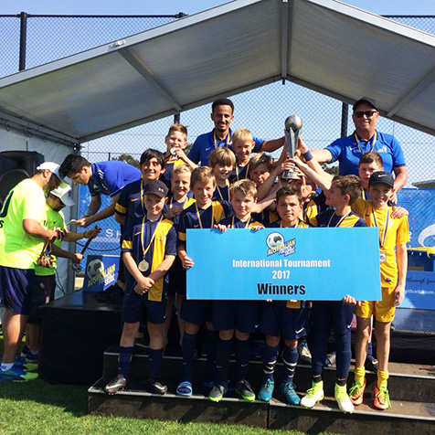 U-11 boys win trophy
